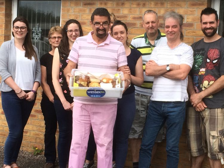 The staff at Creeds with a lovely box of buns.